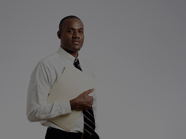 Young businessman holding folder smiling at camera