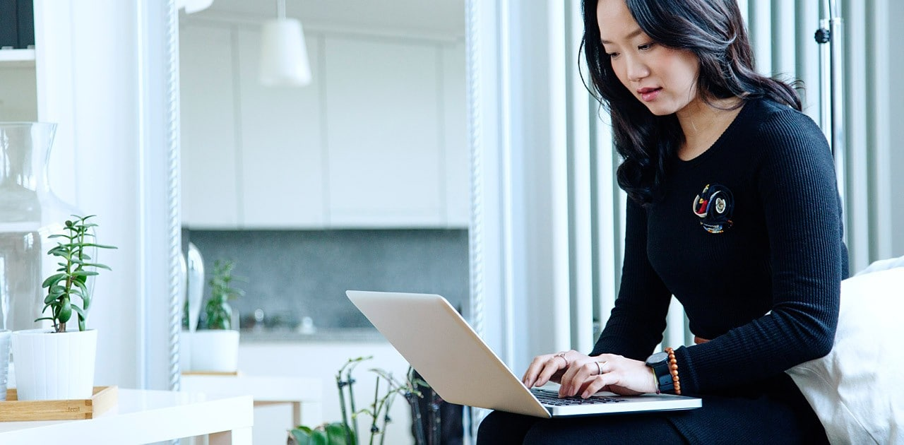 woman working at laptop image