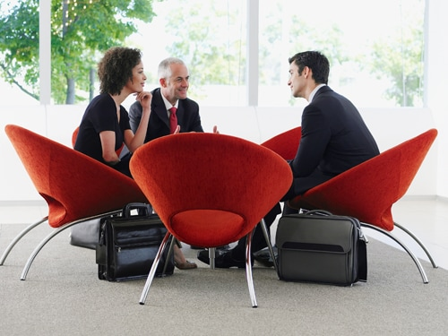 Business meeting in red chairs