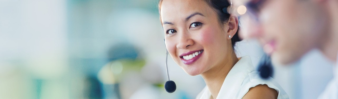 Young asian business woman on headset at call center
