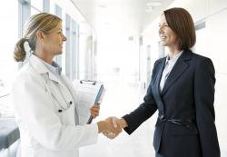 doctor greets business person