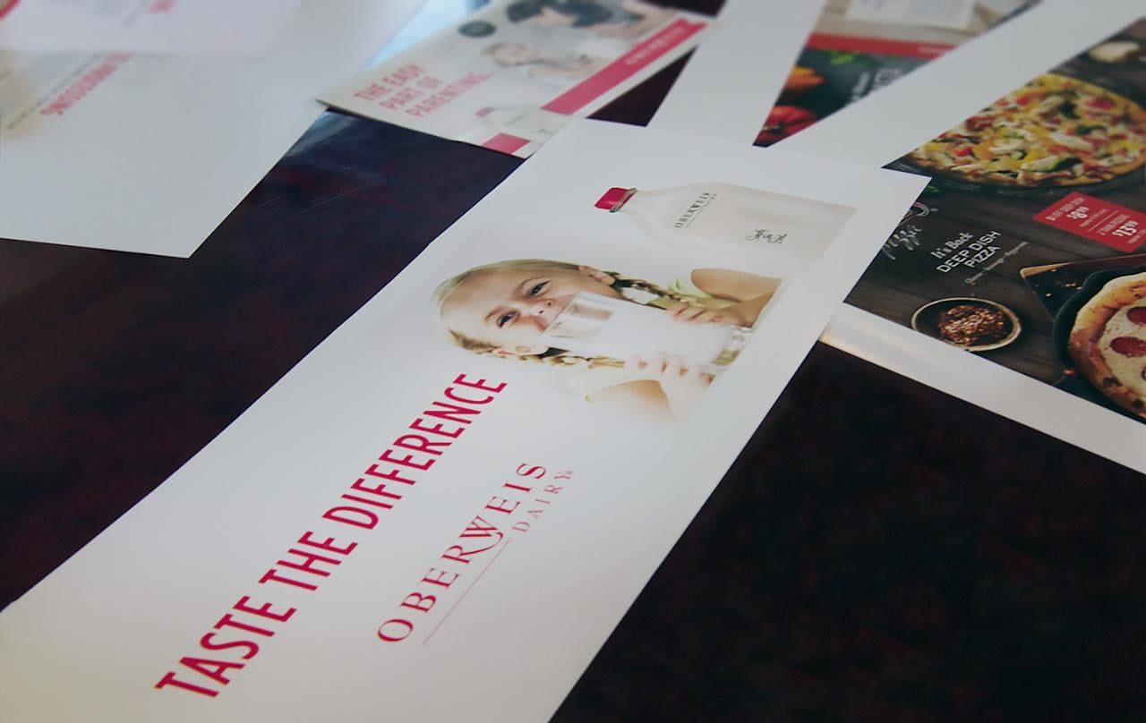 Oberweis printed direct mailers and advertisements laying on conference table