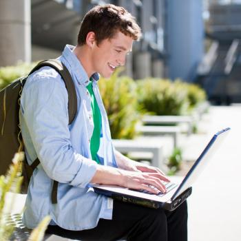 Boy looking at computer