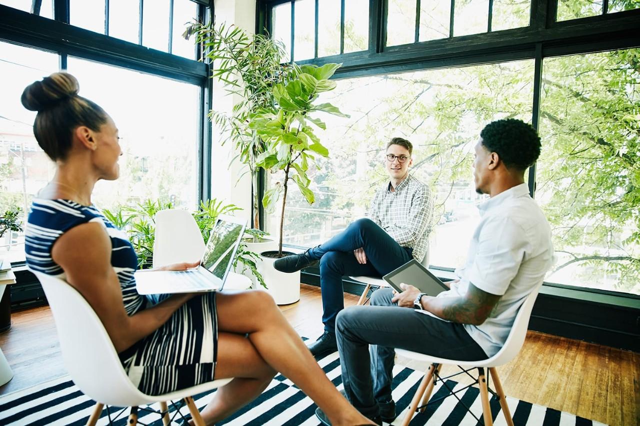 Coworkers having informal meeting in start-up office
