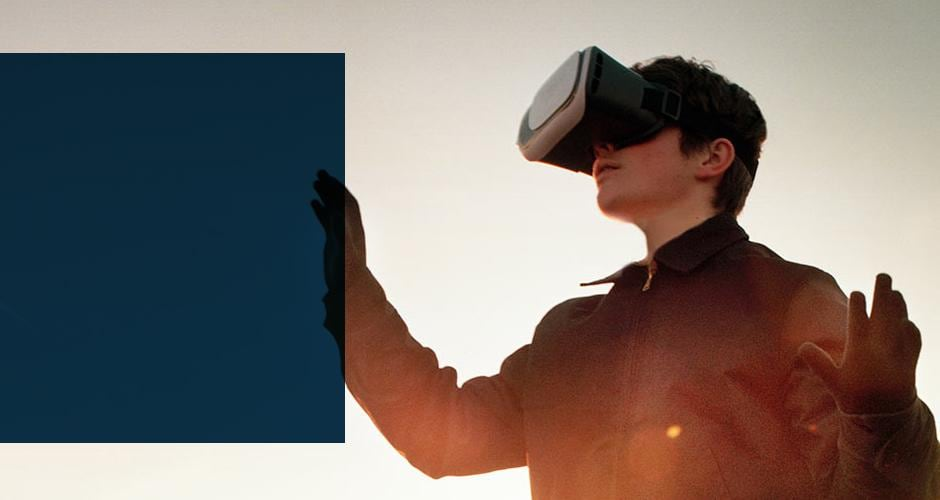 Young man outdoor with VR goggles on