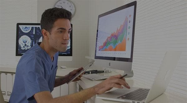 Crescentcare video thumbnail - doctor using computers
