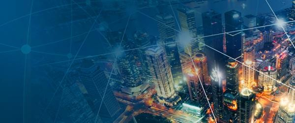 Stylized image of city at night with connecting dots