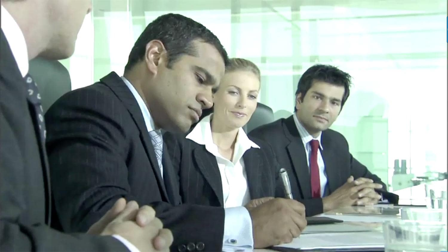 Business people signing papers