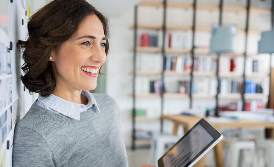 Businesswoman holding digital tablet in office