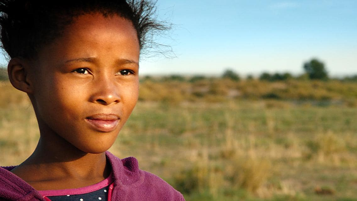 Young indigenous girl standing in plain