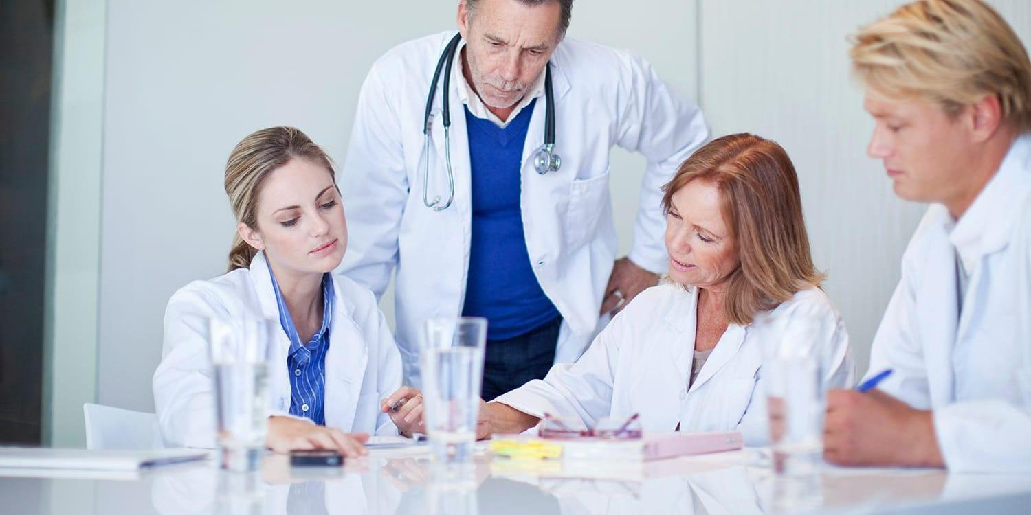 Group of medical professionals conferring in a meeting