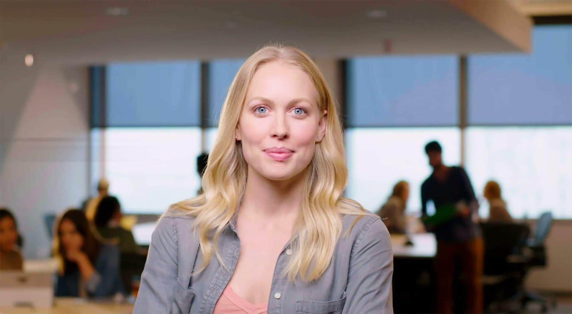 Woman looking at camera in office setting