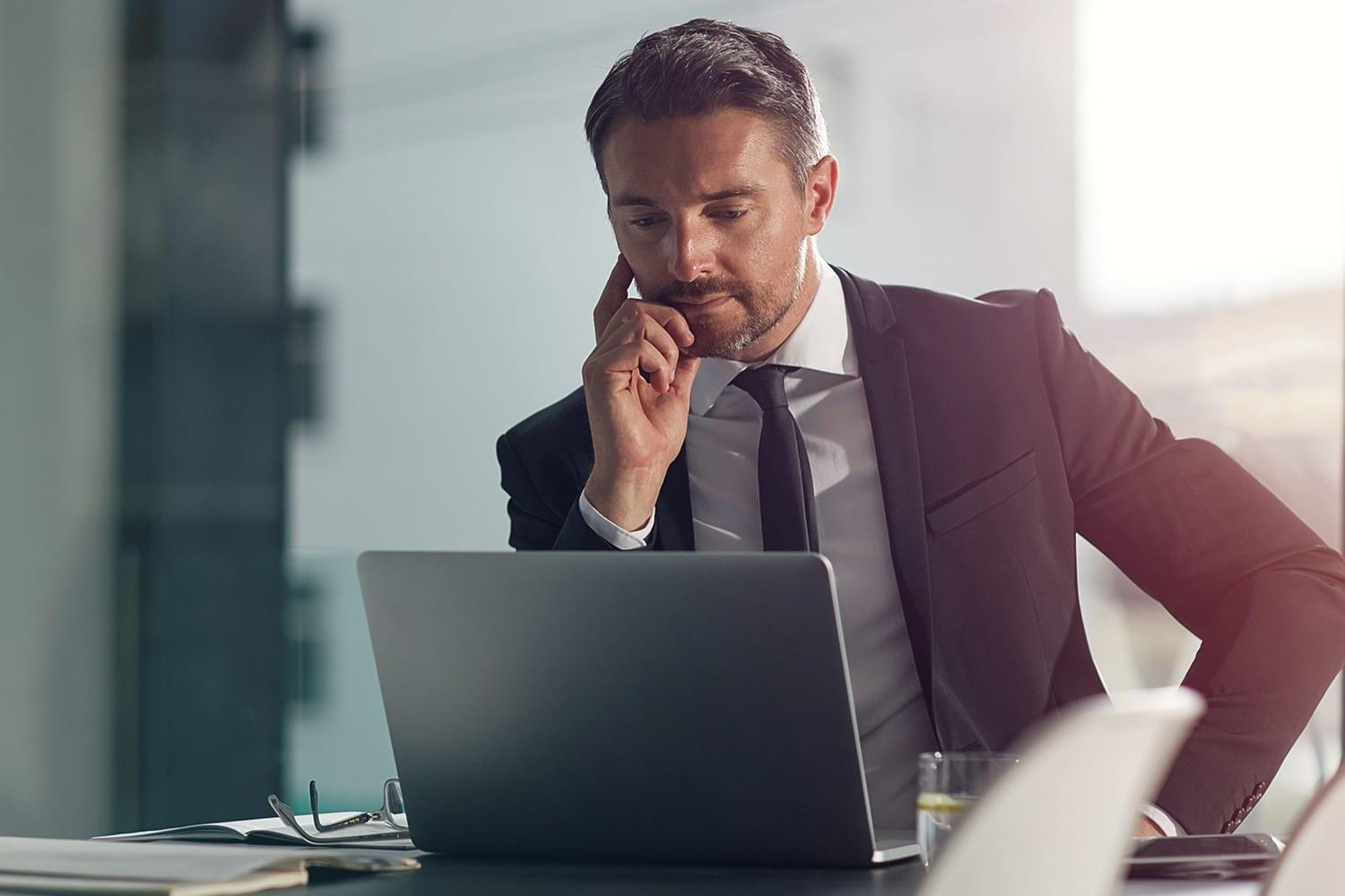Business man working on laptop in office