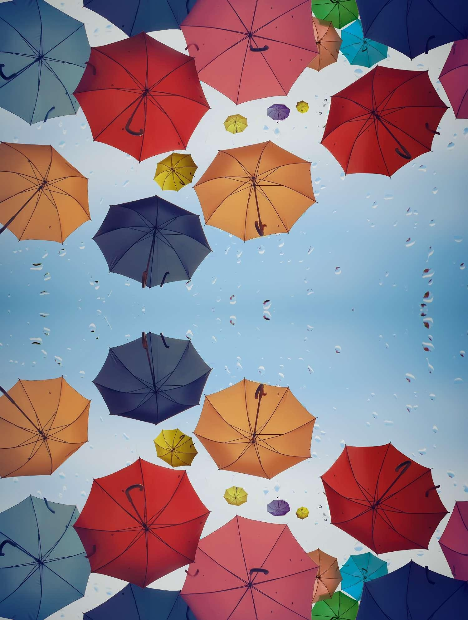 Colorful umbrellas floating in the air on a rainy day