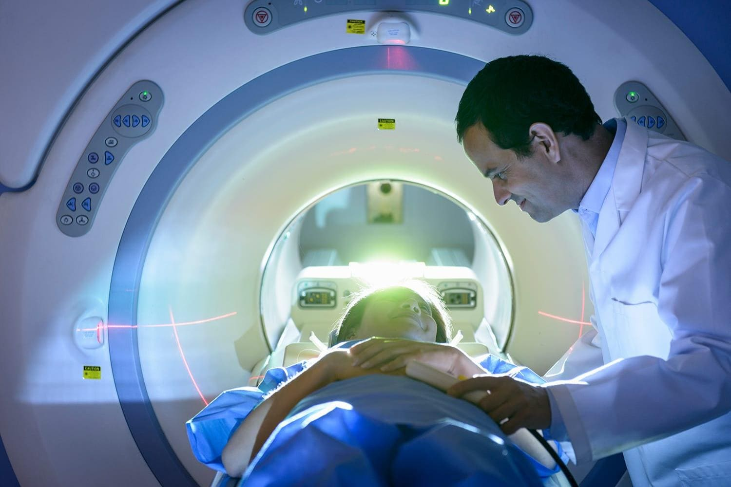 Doctor and patient using MRI machine