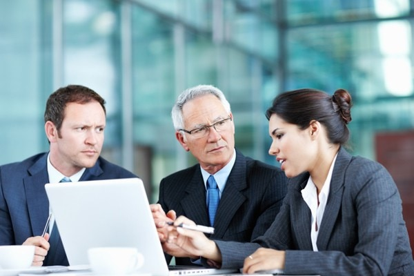 three business people discussing presentation