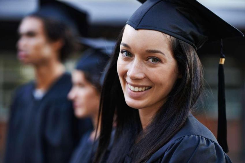 Recent college graduate smiling