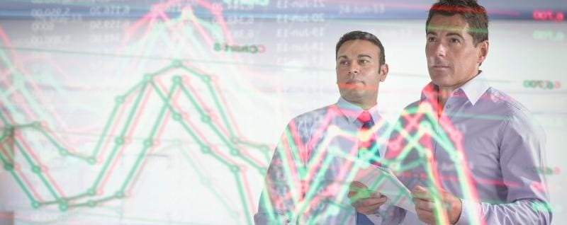 Two businessmen looking at futuristic wall display