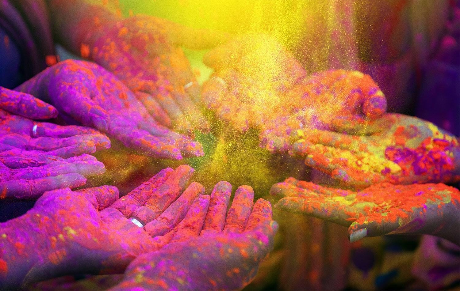Hands in circle with colorful holi powder