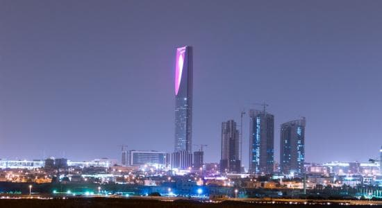 Outside distance skyline view on Riyadh Kingdom tower and other skyscrapers at night
