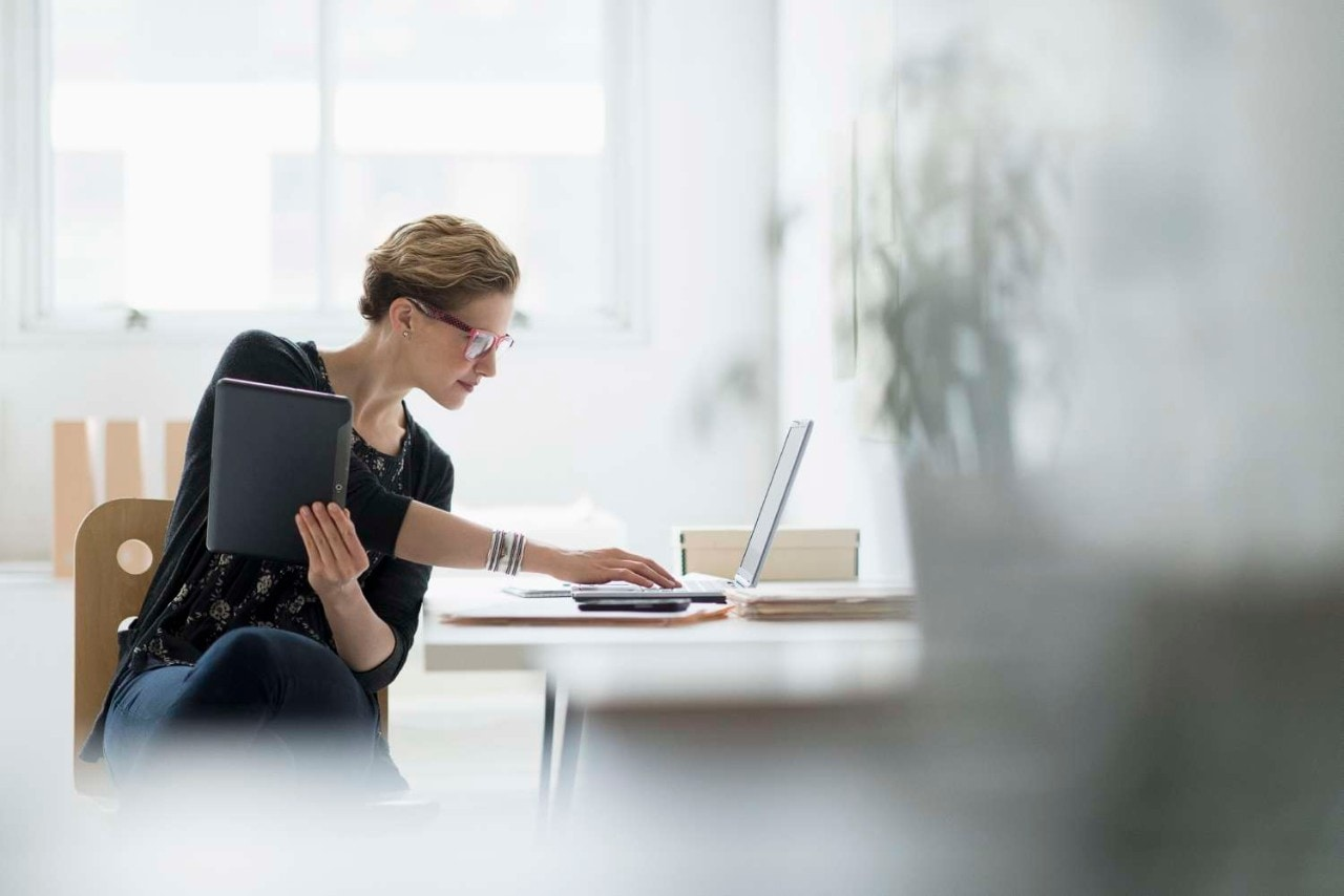Lady Working on Laptop and a Tablet