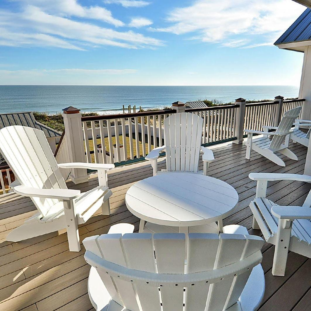 Patio furniture on the Twiddy & Company deck, overlooking the ocean