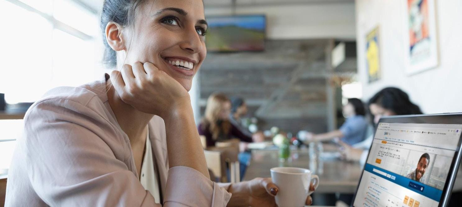 Woman at computer sitting in cafe