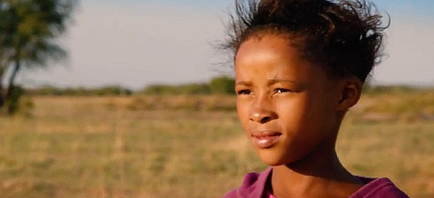 Namibian girl looking over he plains