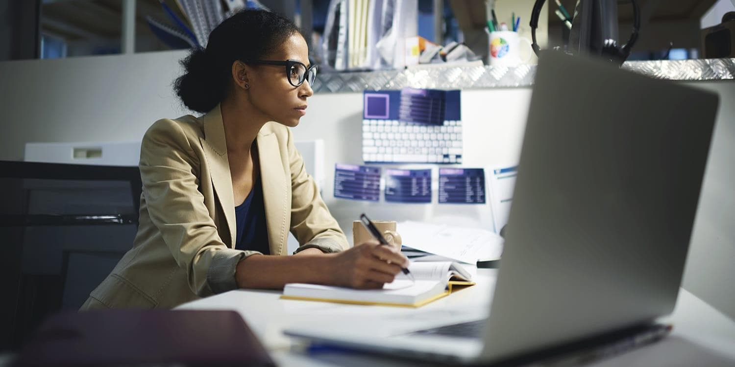 Woman at desk working on laptop