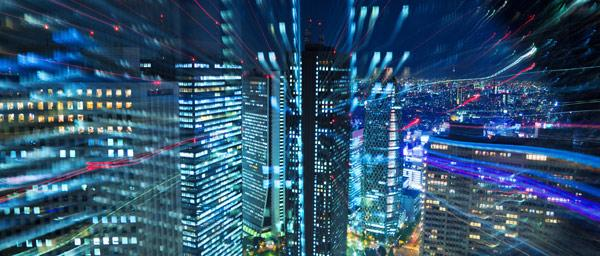 City skyline at night, speed