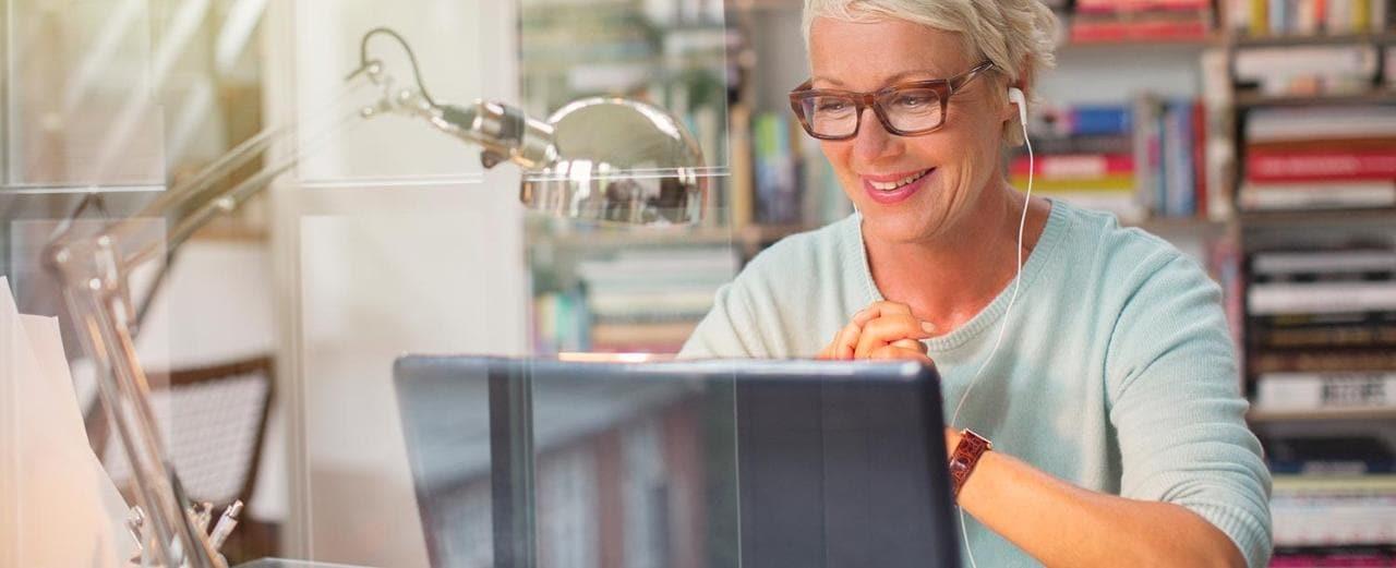 Educator working on laptop
