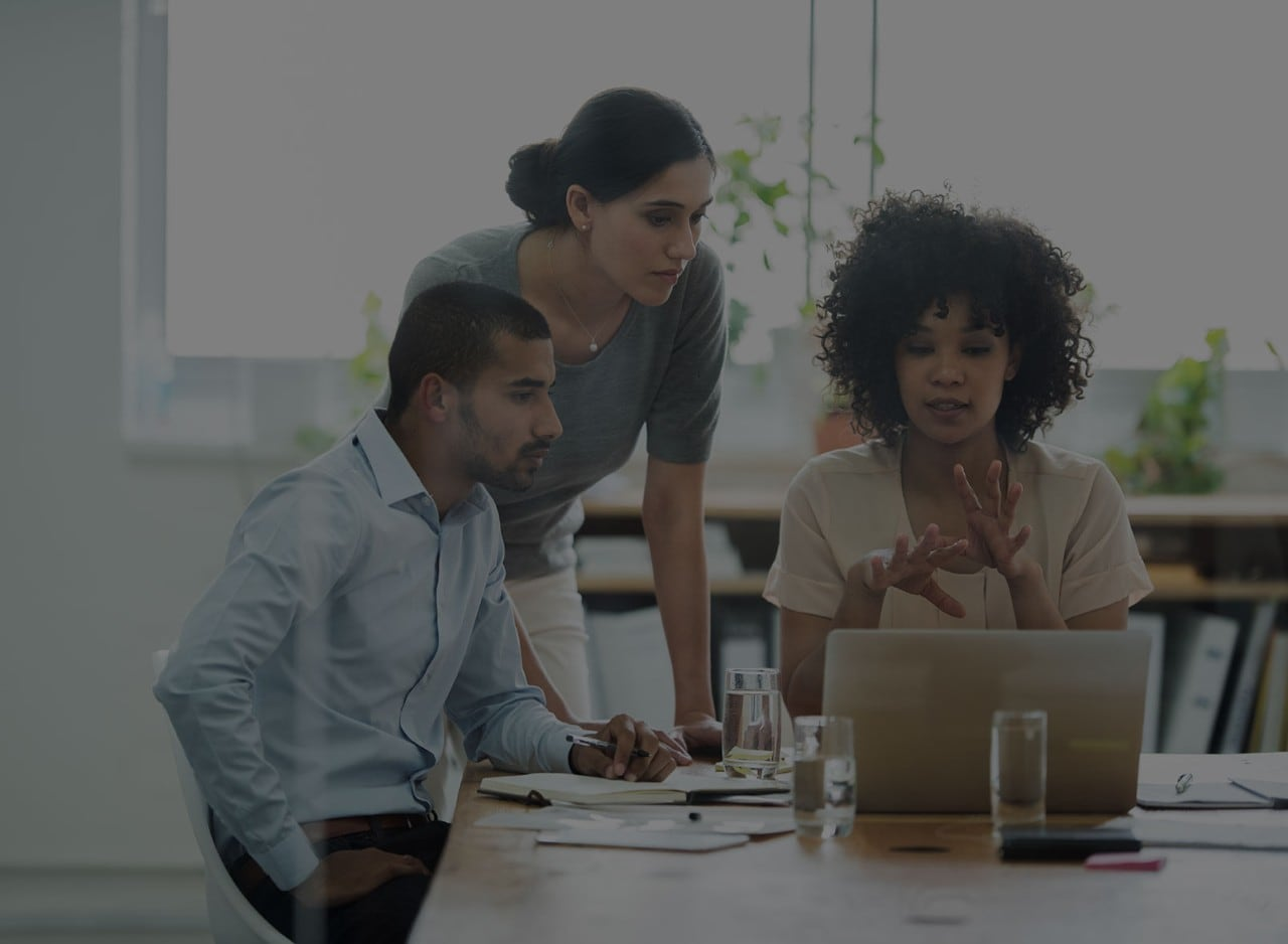 Group of People Communicating in Front of Computer