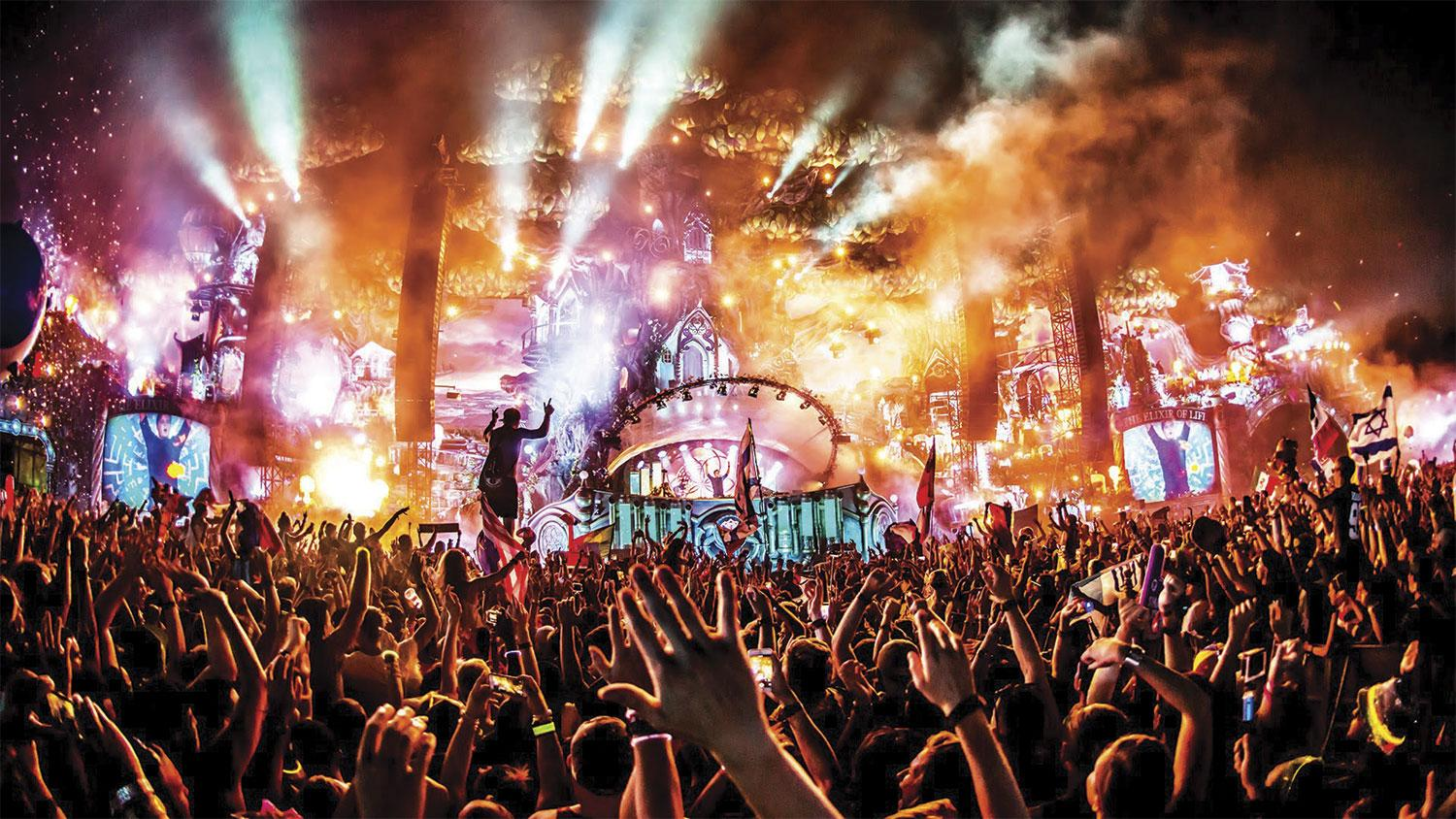 People partying at one of the Tomorrowland festival stages