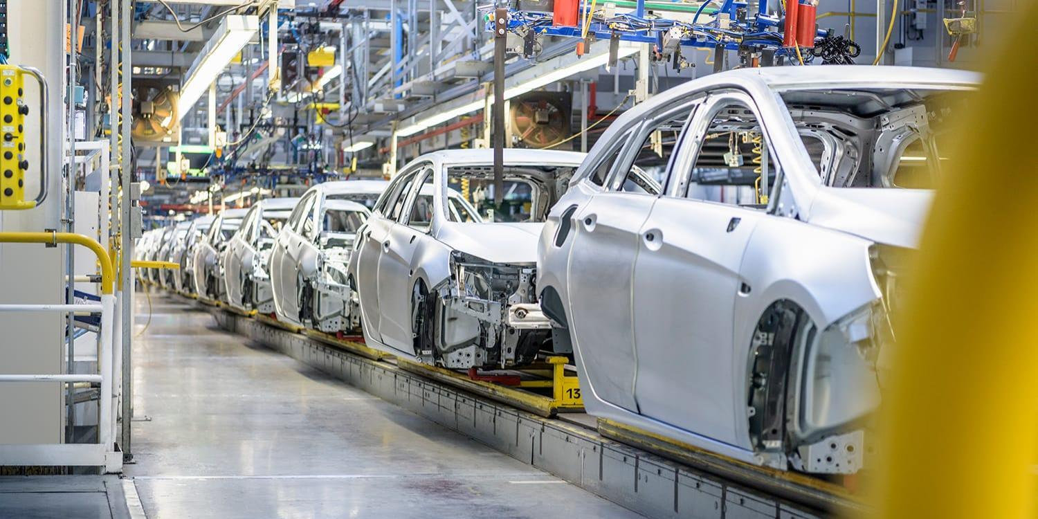 Cars in production assembly line