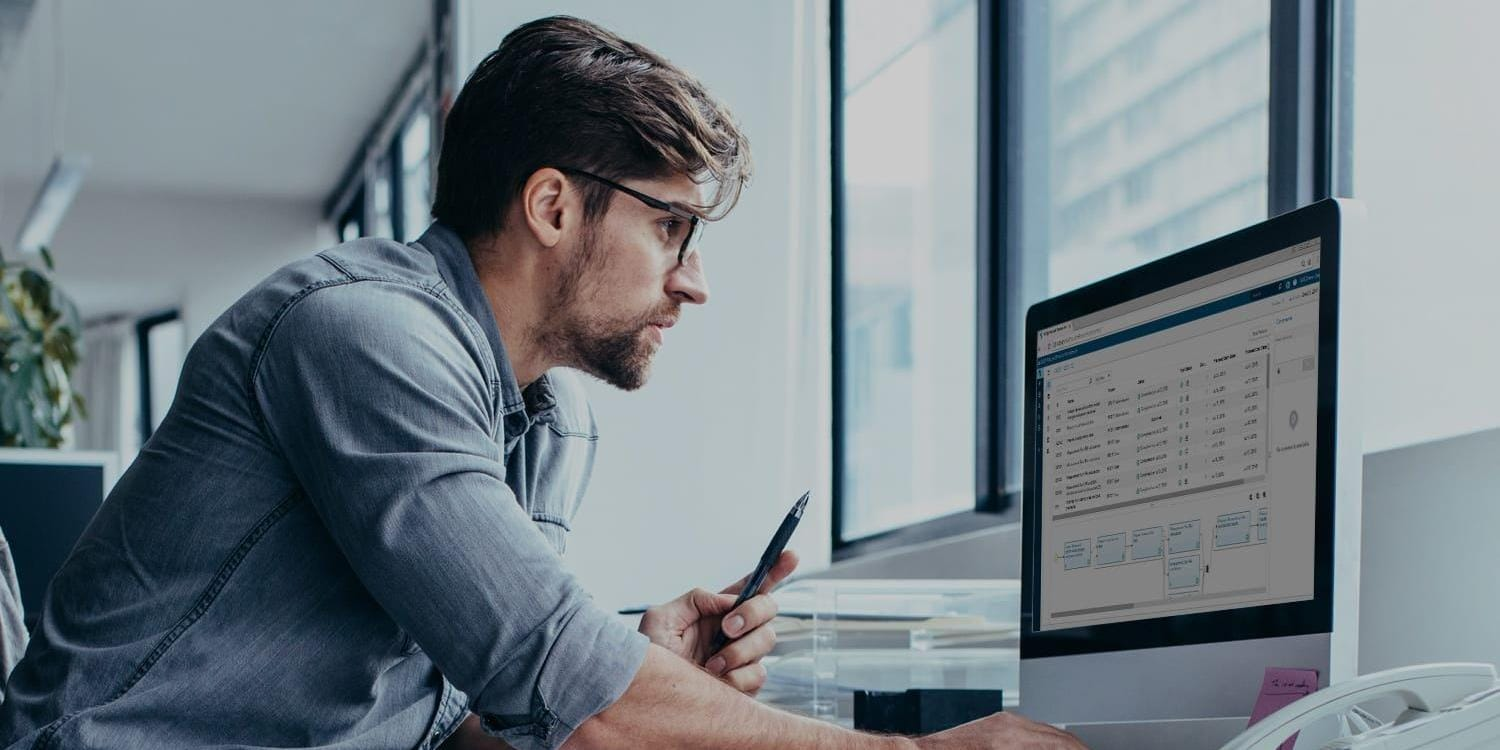 Man working diligently at computer in office