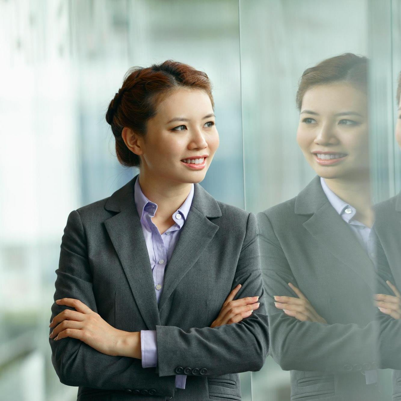 Business woman looking at her reflection