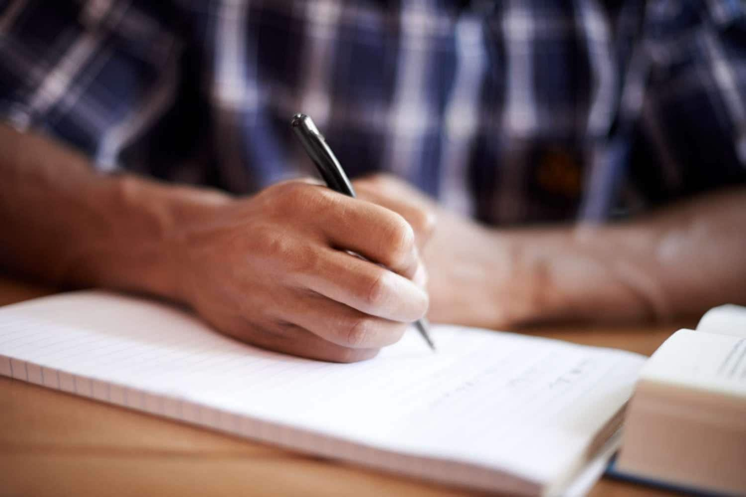 Man writing on paper