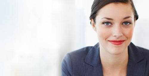 Young businesswoman with brown hair and red lipstick