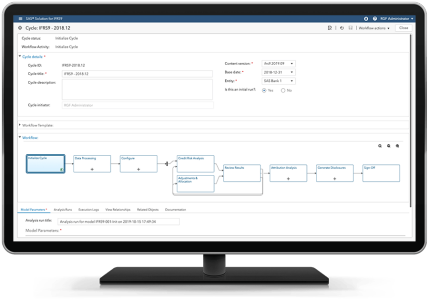 SAS Solution for IFRS 9 showing workflow on desktop monitor