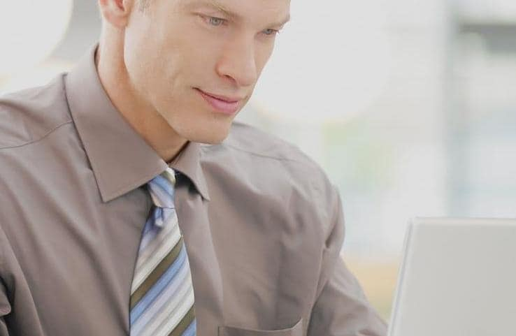 Business man with laptop and cup of coffee