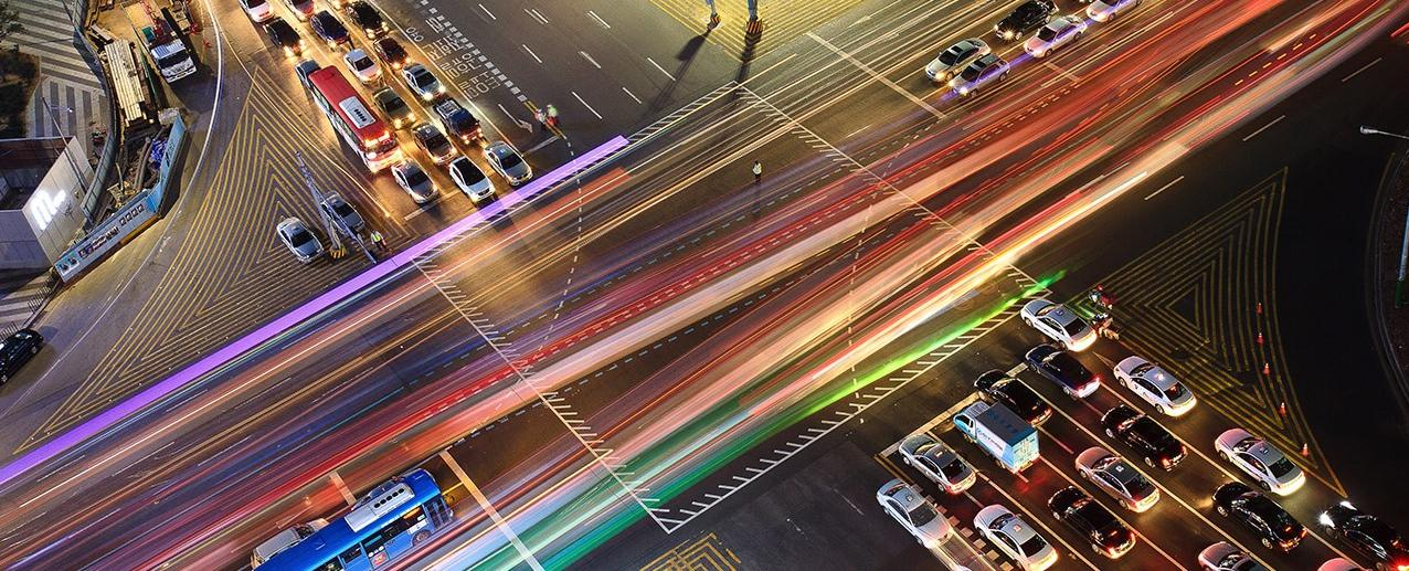 cars at busy intersection at night