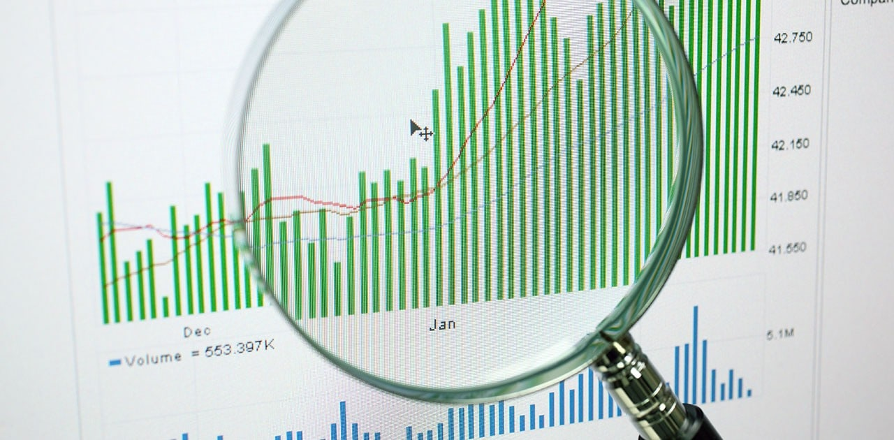 magnifying glass over data charts