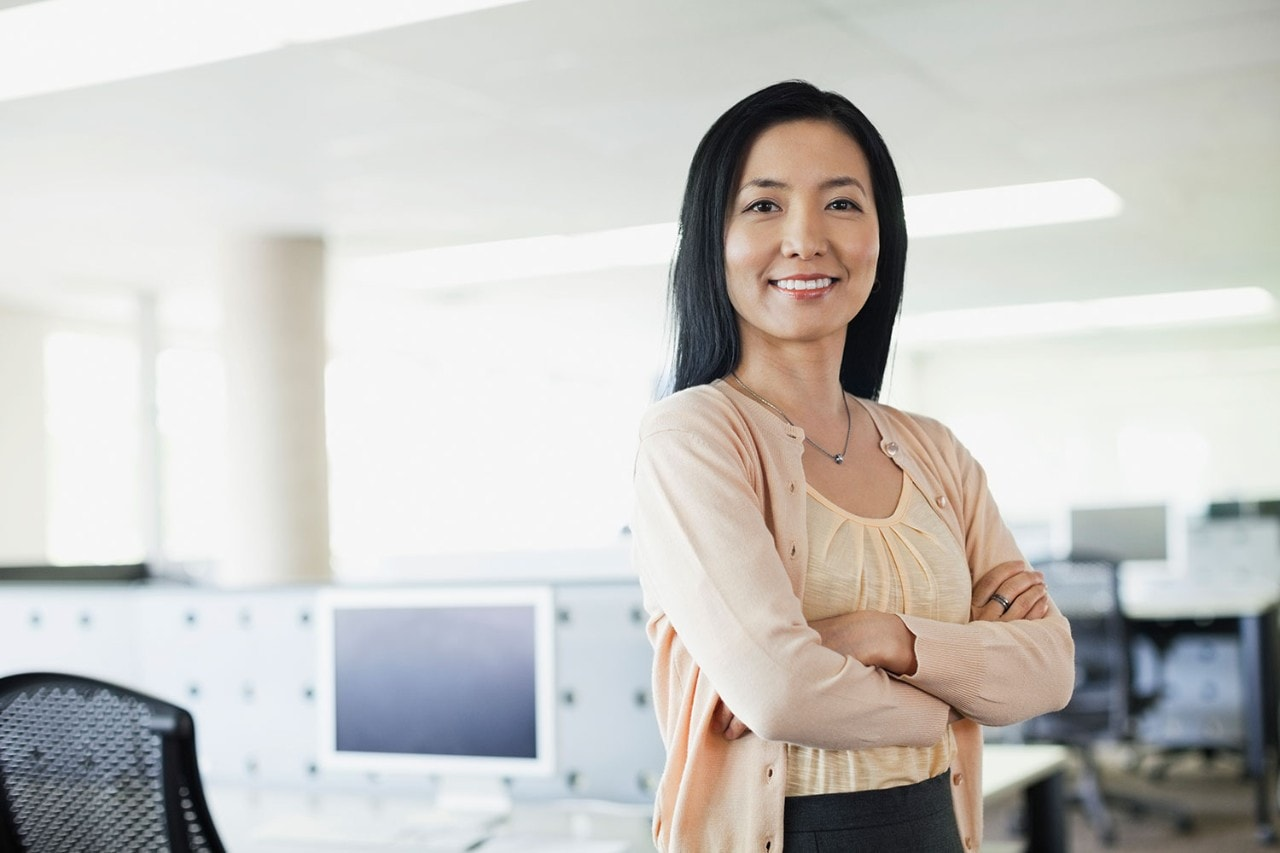 Asian Woman Standing In Office