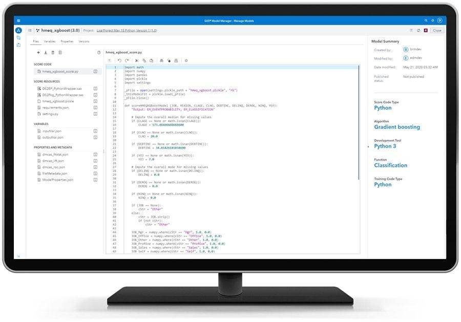 SAS Model Manager showing executable score code on desktop monitor
