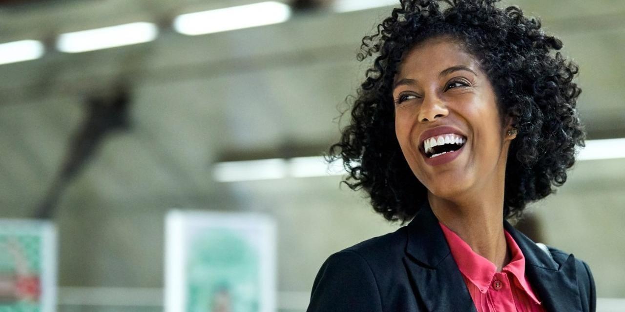 Happy business woman walking