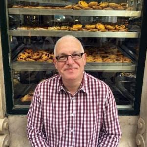 Nigel Armstead in front of bakery window