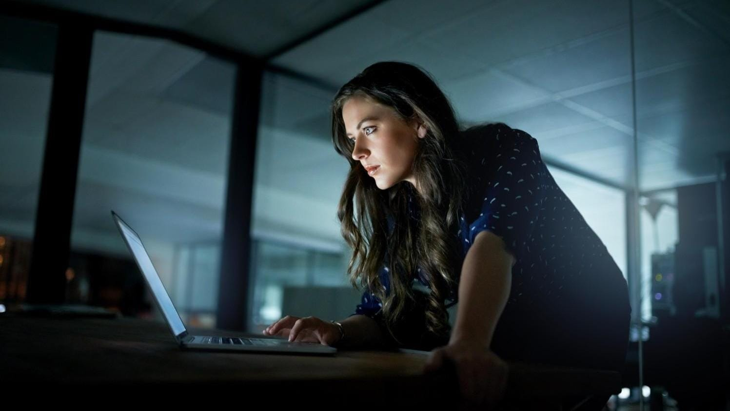 Woman working late at night