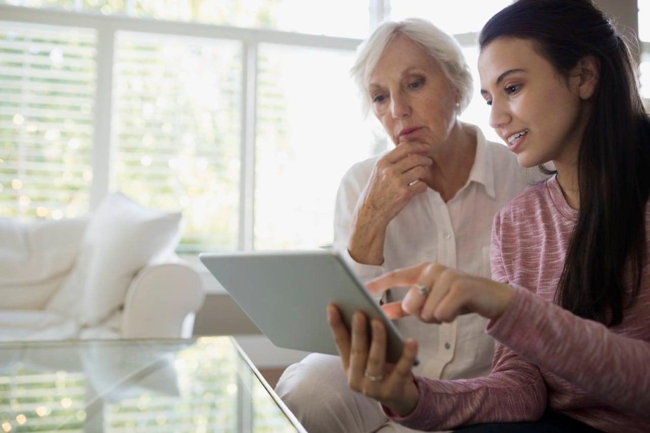 Two Women Using Digital Tablet