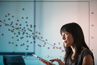 Mature woman using digital tablet with diagram of shapes