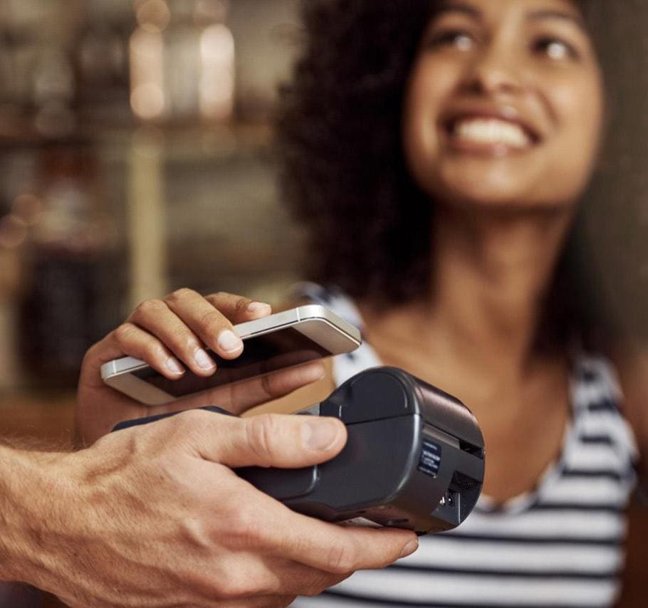 Woman using Apple pay on iPhone